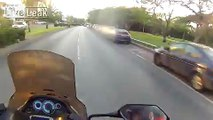 Cop biker goes flying in the air trying to run a red light