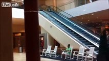 Chinese guy slides down the escalator Fail!