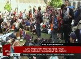 Anti-austerity protesters hold 'die-in' outside parliament in London