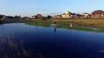 Drone view father/son fishing lake Pville