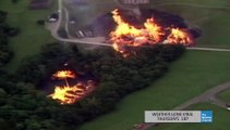 Incredible fire tornado : 3 millions liters of Whiskey burning in lake after lightning strike destroyed a warehouse
