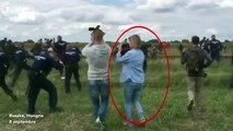 Une opératrice de télévision donne des coups de pied à des migrants en Hongrie
