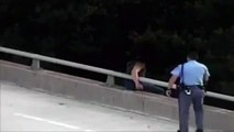 Cop saved a man jumping off; gave him a hug!