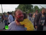 Blood and Tears: Chaotic scenes at Hungarian border as refugees come under tear gas