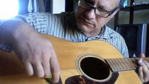 How to string a steel string acoustic guitar by Shaolin guitar teacher - Mobile