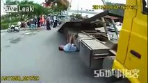 Guy hangs under tow truck to prevent his car from being impounded