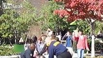 LiveLeak.com - College student slammed to ground for questioning street preacher