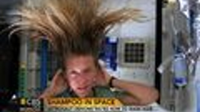 Astronaut washes hair in zero gravity