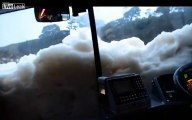 Bus submerged by sea foam during storms