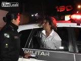 Drunk woman freaks out when arrested.