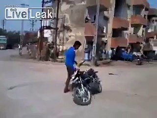 Indian guy showing off with the motorcycle trick