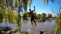 Crazy Tightrope Walker walks on slackline over Alligators Pool