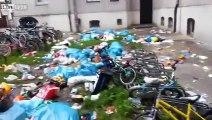 Des migrants balancent leurs poubelles par la fenêtre de leurs logements