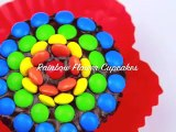 RAINBOW FLOWER CUPCAKES Make these chocolate frosted cupcakes with mini M&Ms for your part