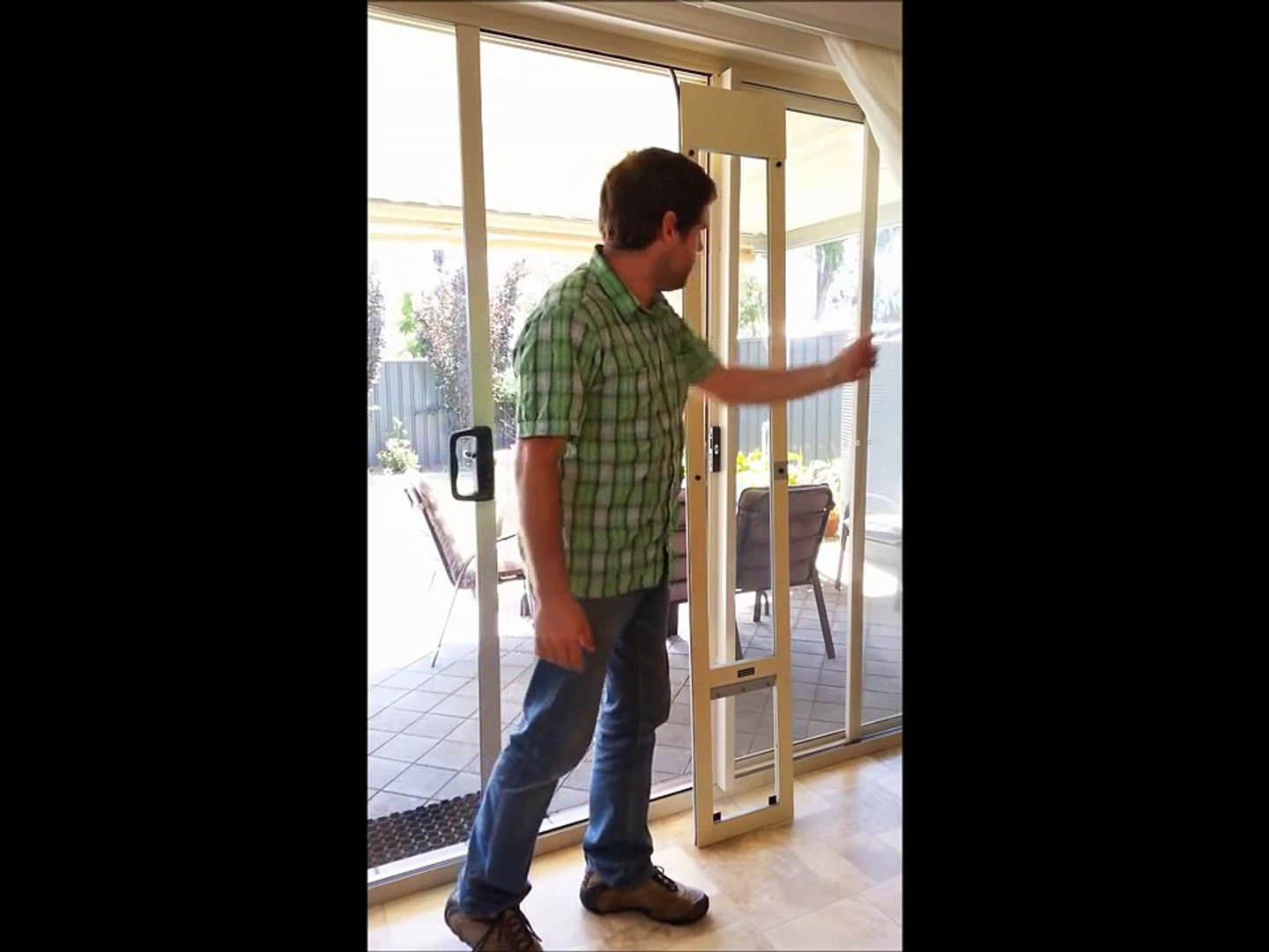 Installing a pet door in a sliding glass door by Modern Pet Doors (fast fit)