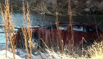Fisherman finds baby alive beside her dead mother in semi submerged wreck of car