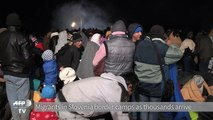 Migrants in Slovenia border camps as thousands arrive