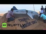 'Tribute to innocent souls': Artist creates sand sculpture of 7K9268 plane to commemorate victims