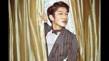 Lee Joon gi — wears a white satin suit and poses against gold drapes in Elle