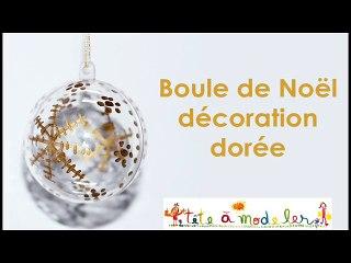 Boule de Noël à la décoration dorée