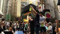 Hong Kong protesters defy Beijing, pack streets