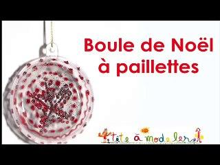 Boule de Noël transparente motifs rouges