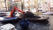 How bicycle wrecks are fished from the canals of Amsterdam