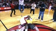 LeBron tackles a Heat fan who hits a $75,000 shot!.