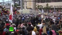 Scuffles, water cannon as protesters rally against APEC summit in Manila 2015
