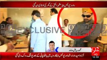PPP's Pir Mazhar ul Haq's son Danish Ali in polling stations with a Police walky talky
