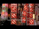 Hindu religious stickers on sale during Diwali in Agra