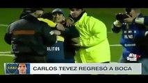 Carlos Tevez abraza a unos aficionados que invadieron el campo en su Presentacion con Boca Juniors