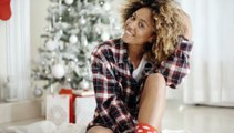 Thoughtful Woman In Front Of a Decorated Xmas Tree | Stock Footage - Videohive