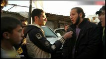 Syrian rebels withdraw from Homs following peace deal