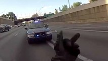 A policeman asks a wheeling then tries to stop the biker