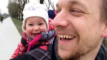 Baby laughing while her dad tries to make her say 'daddy