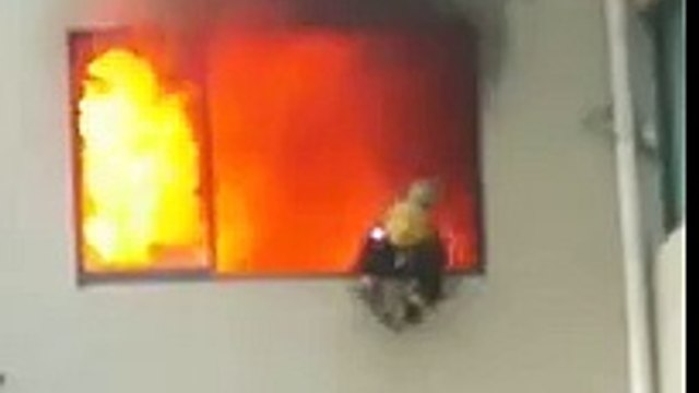 Chinese firefighter trapped in burning house