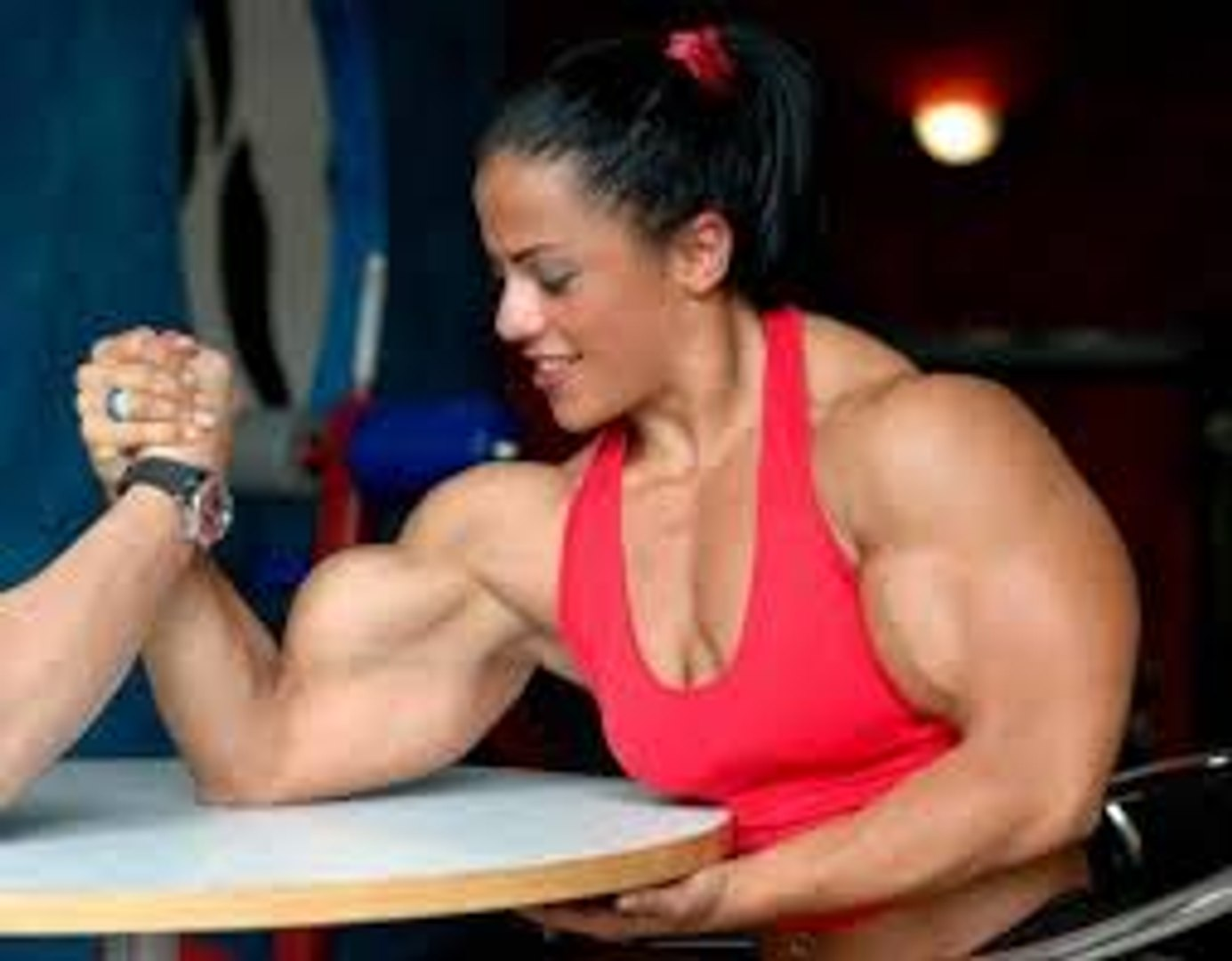 Armwrestling. Girl confronts man in manual sport