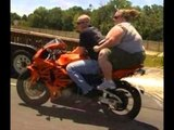 how the fat women behave with this man and his bike must watch this video . HOW THIS man adjust this healthy one .