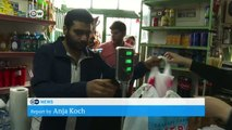 Greek village copes with influx of refugees | DW News