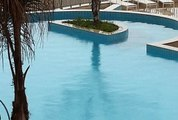 super lux apartment for sale or rent in Uptown Cairo second floor on the pool.
