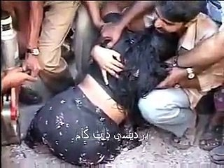 Indian People tease woman stuck in concrete at road