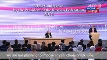 Putin says Russia not planning sanctions against Ukraine