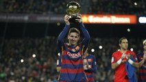 Messi offers the Ballon d'Or to the FC Barcelona supporters at Camp Nou