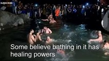 Russians brave snow for icy Epiphany dip - BBC News