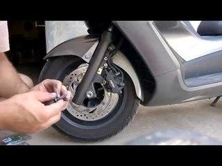 guida: come sostituire le pastiglie dei freni anteriori allo scooter honda sw-t