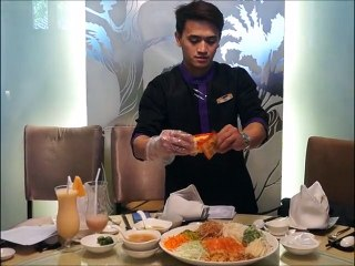 Prosperity Toss Salad Tossing at Crystal Jade Dining In