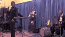 Male jazz singer and jazz trio in concert. Chicago hotel jazz band, Sinatra