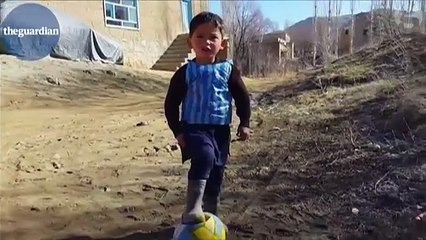 Afghan boy sports Lionel Messi football shirt made from plastic bag