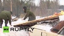 En Russie, c'est volontiers qu'un véhicule d'infanterie tracte un snowboarder